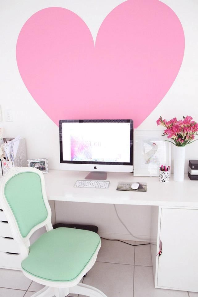 Deck out your space with over-sized decorations and pastel colors, like this giant heart and mint chair, for some cute sophistication.