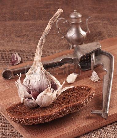 Fresh Garlic and bread on a cutting board