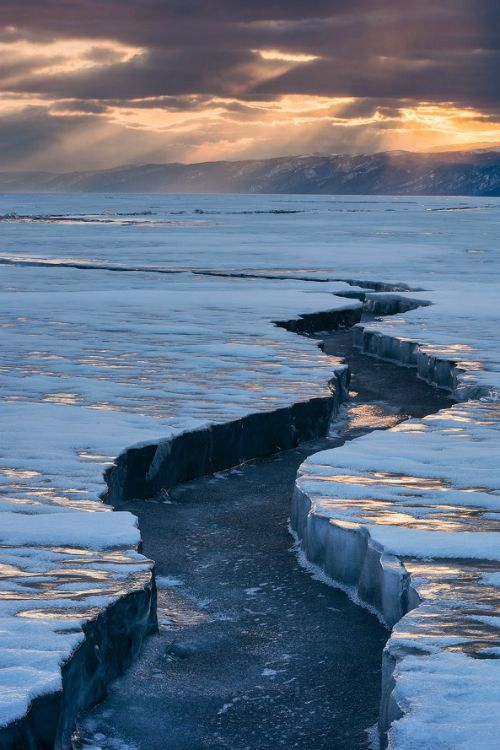 Lake Baikal, Russia, SE Siberia.  Lake Baikal is a freshwater lake with the greatest volume in the world and home to more than 1,700 species of plants and animals, 2/3 of which can be found nowhere else in the world.