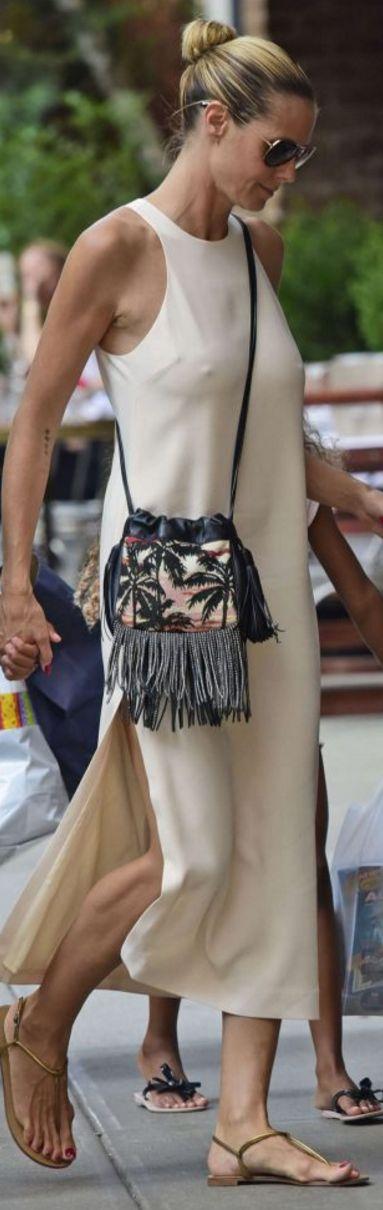 Who made  Heidi Klum's white dress, sunglasses, and black print fringe bucket handbag?