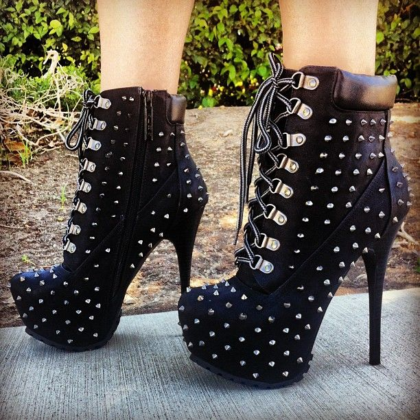 Black spiked lace-up high heel booties #boots omg these are to die for....can someone please tell me where to get them????