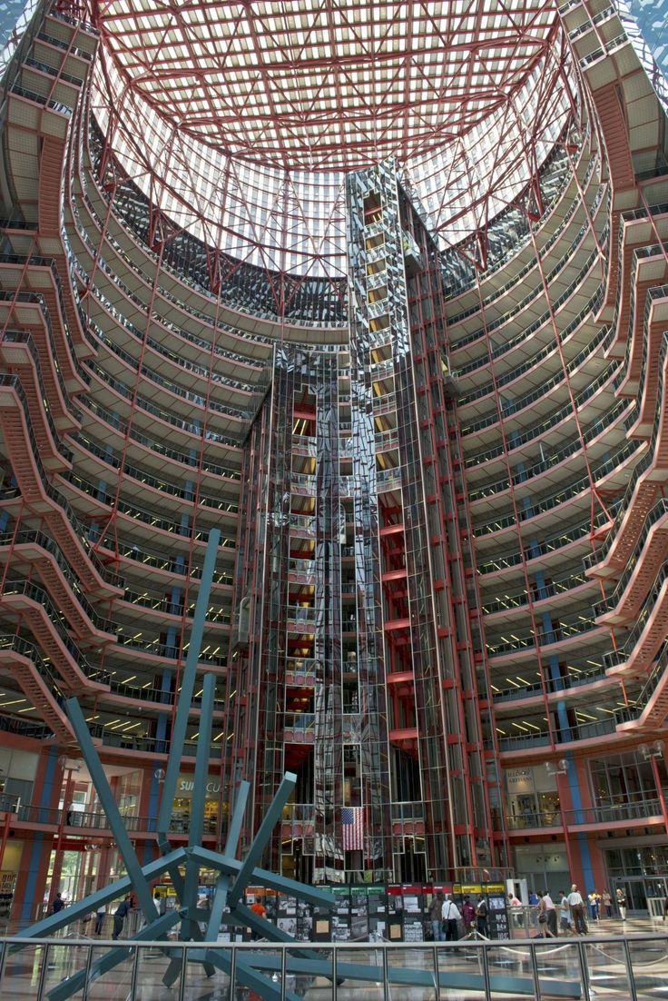 Thompson Center (1985 by Murphy/Jahn) When you first encounter the Thompson Center, you might wonder if a UFO has landed in the middle of the Loop. The Helmut Jahn-designed center of state government is unabashedly Postmodern, with colorful details and a shape that references the dome of the state's capitol.