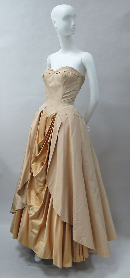 1948 Charles James Silk Ball Gown US. In 1948 Vogue shoot by Cecil Beaton, this is 1 of James' iconic designs. He produced some of the most memorable garments ever made. He began his career in the 1930s + peaked from the mid-40s thru 50s. He personally draped + constructed his garments that bear the Charles James label, considered to be the only American to work in the true couture tradition. Used many historical references in shapes + construction, esp. draping from 1870s + early 20th c.