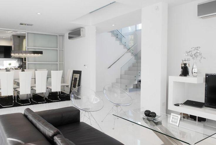 Altos House (2010) Proyecto, Dirección de Obra y Construcción  #Arquitectura #Architecture #Disenio #Design #SittingRooms #SalaDeEstar  Más información: http://vanguardaarchitects.com/es/what-we-do.php?sec=house&project=37
