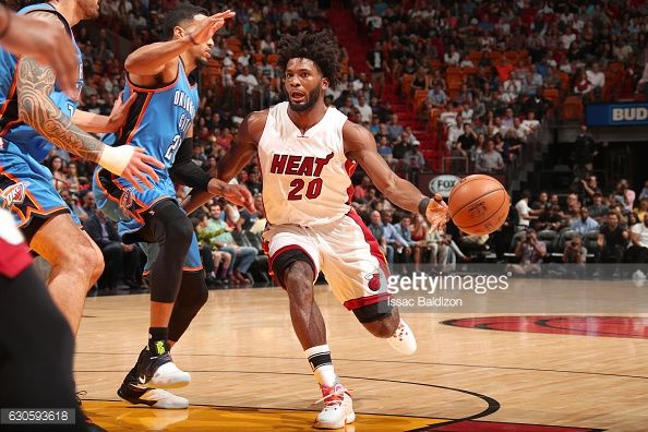 News Photo : Justise Winslow of the Miami Heat passes the ball...