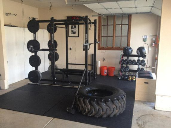 Very nice garage gym photo. Rogue R-6 Power Cage, bumpers, hammer, even a giant tire to smash and flip. #garagegym