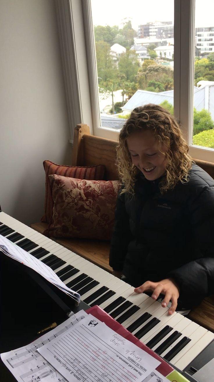 Charlotte playing piano