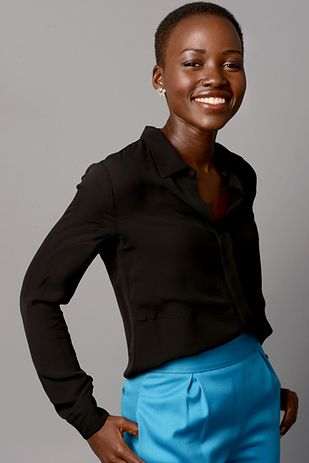 """She knows how to rock a colored pant.   Why """"12 Years A Slave"""" Star Lupita Nyong'o Should Be Your New Fashion Idol"""