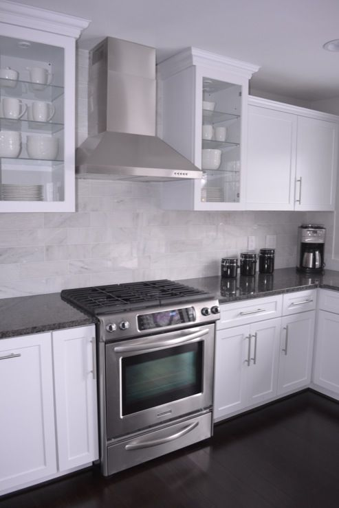 kitchens - white cabinets, steel gray granite, carrara marble back splash, bamboo floors, stainless steel hood, steel gray granite counters, steel gray granite countertops,