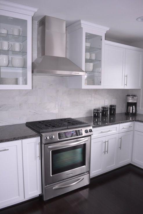 kitchens - white cabinets, steel gray granite, carrara marble back splash, bamboo floors, stainless steel hood, steel gray granite counters, steel gray granite countertops,
