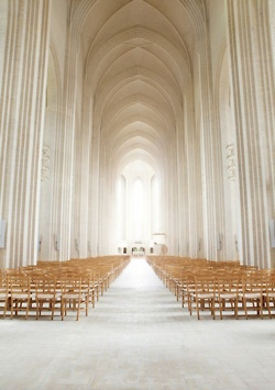 Majestic!  via Grundtvig, Copenhagan. Almost seems like you are walking in the hallway of heaven.