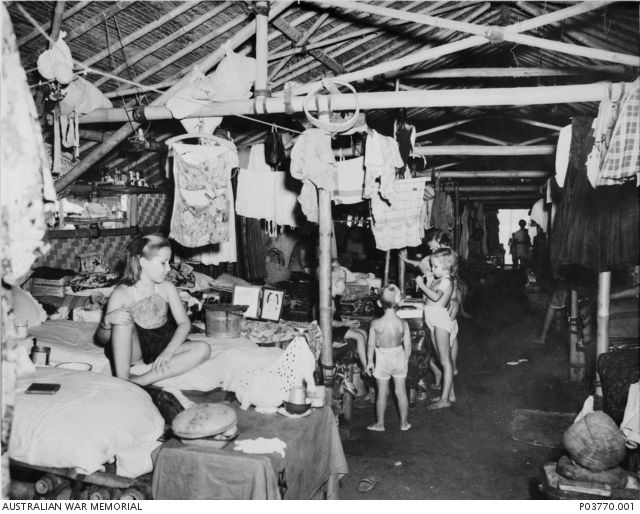 Civilian internees lived in crowded, insanitary conditions such as this one, in Java, for over three years