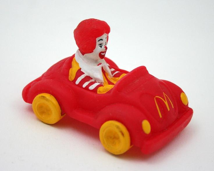 Vintage Ronald McDonald, VW bug, red car, yellow, clown