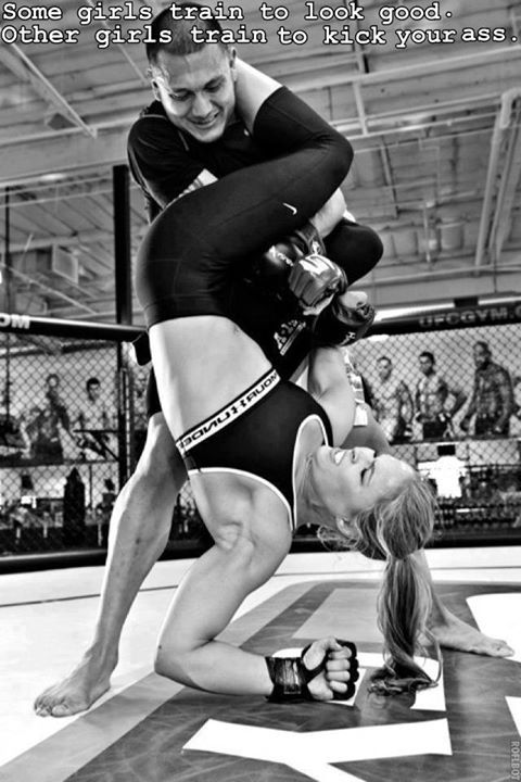 "Ronda Rousey in action UFC MMA.  ""Some girls train to look good. Other girls train to kick your ass."""