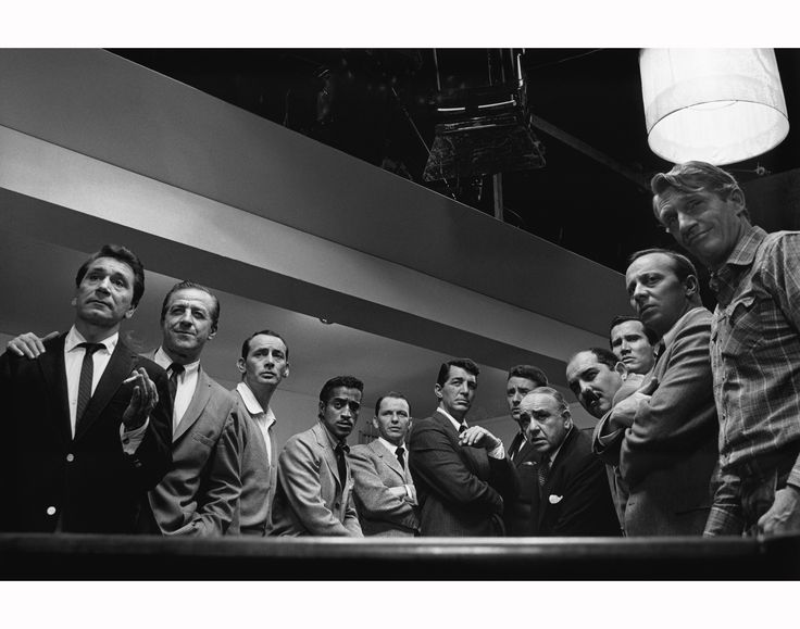 Richard Conte, Buddy Lester, Joey Bishop, Sammy Davis Jr., Frank Sinatra, Dean Martin, Peter Lawford, Akim Tamiroff, Richard Benedict, Henry Silva, Norman Fell and Clem Harvey in Ocean's 11. 1960