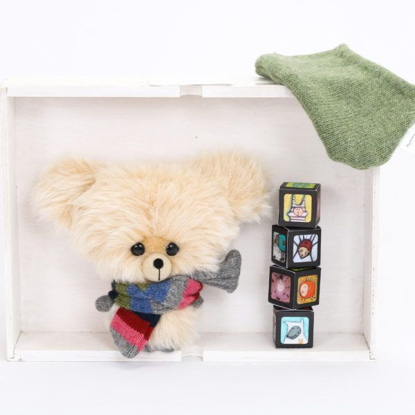 Butter-colored, handmade teddy bear with big head.These adorable big-headed bears are designed to express love, appreciation and care. They tell more than a hundred words.