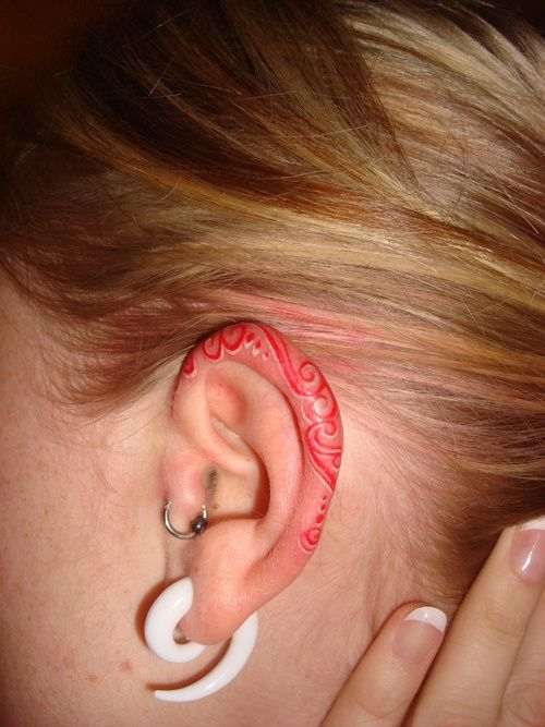 Ear tattoo ~this is so awesome! i think ive added that to my HUUUUUGE LIST OF FUTURE INK LoL except maybe turqouise or emerald. hmmm....~xoxo~