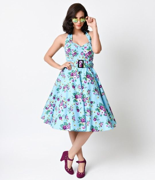 Let Spring sing, dames! A vibrant sky blue retro dress from Hell Bunny, The May Day dress is a floral halter guaranteed to brighten any room you walk into. Patterned all over in a warm and vibrant spring rose floral print and cast in a sturdy cotton blend
