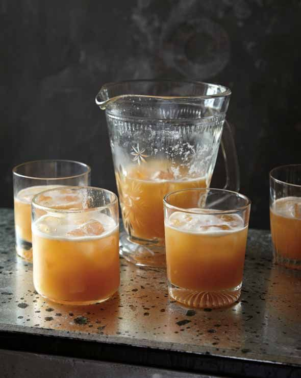 Tangerine Whiskey Sour Recipe (This contemporary whiskey sour recipe calls for bourbon, tangerine and lemon juice, sugar, and bitters. Best make a big batch and serve it from the punch bowl.)