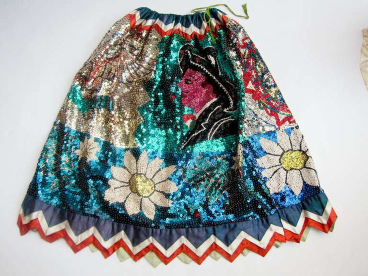 Few indigenous dresses of Mexico compare with the literal brilliance of the 'China Poblana,' the blouse with rich embroidery and the skirt covered in sequins in an elaborate design. Description from 1stdibs.com. I searched for this on bing.com/images
