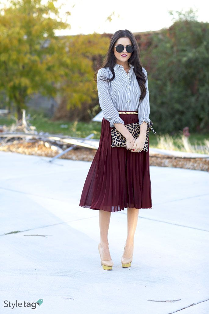 A pop-out clutch is a must have for all those #fall activities! #StyletagApp. Maroon, light blue, animal print. Classic feminine look. But with a longer skirt.