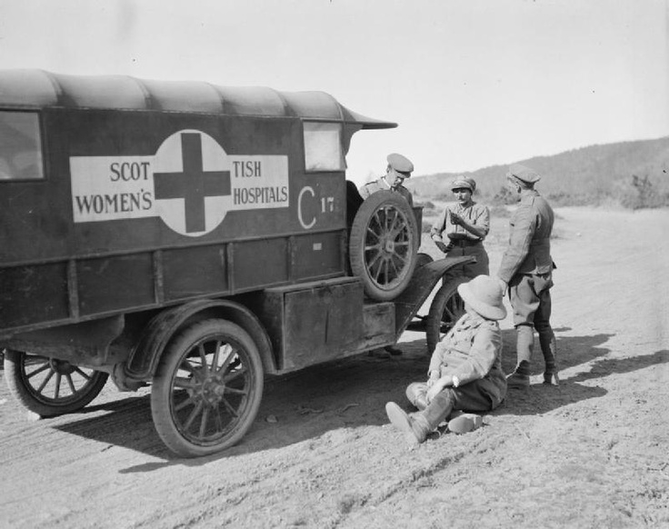 A motor ambulance of the Scottish Womens' Hospital broken down on a hill road, October 1916.
