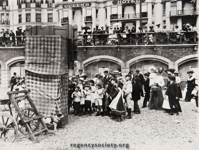 Brighton Beach 26th July 1904. Punch and Judy Show, opposite the Queen's Hotel.
