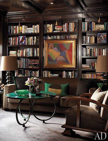 The artwork in the library of a Chicago home by Jean-Louis Deniot is by Serge Poliakoff. The vintage malachite cocktail table is by Maison Jansen.