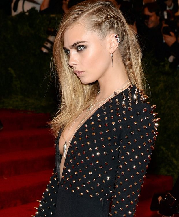 Cara D. fakes asymmetrical cut style with clever braids. Nicely styled with studded dress.