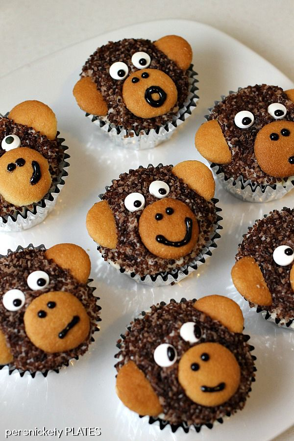 """Adorable Monkey Cupcakes! Chocolate cupcakes with sprinkle """"fur"""" and vanilla wafer ears!"""