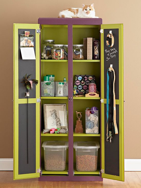 Pet Station. An armoire outfitted with shelves for pet supplies, while the chalkboard inside the doors displays reminders for playdates and appointments. Spacious, divided compartments provide a manageable way to organize treats, toys, and grooming supplies; each one is tall enough to organize bins and boxes of all sizes