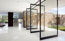 Swing Glass Door With Black Aluminum Frame On White Marble Floor