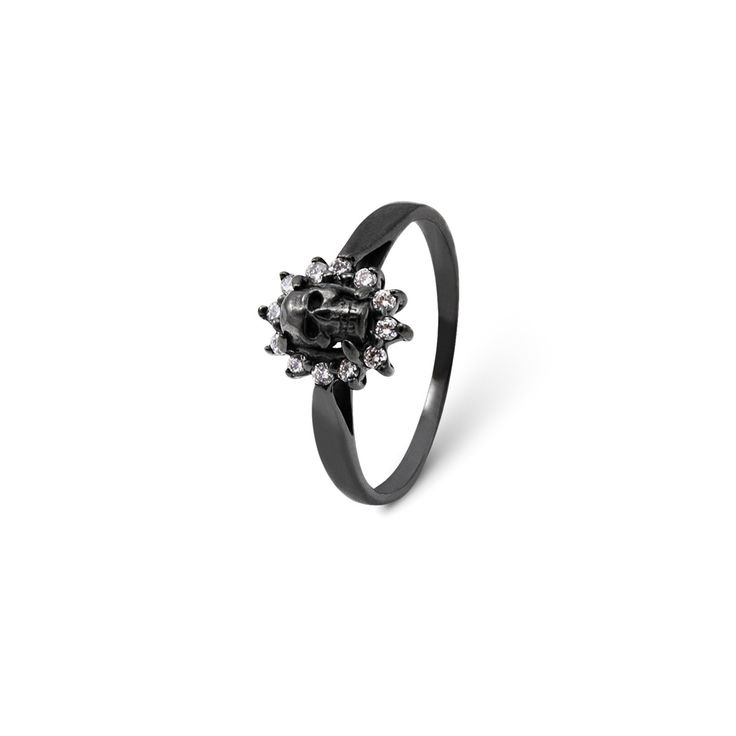 Emerinta Ring - In Oxidised Sterling Silver and Zirconia. Scandinavian Design. From Mari Keto's Memento Mori Collection comes this beautifully macabre black oxidised sterling silver ring. Centered at the top of the band, you'll see a tiny, intricately carved black oxidised sterling silver skull, surrounded by a ring of zirconia crystals. This gorgeous and elegant ring plays with the themes of beauty and mortality. Wear it to start a conversation at any event, formal or casual.
