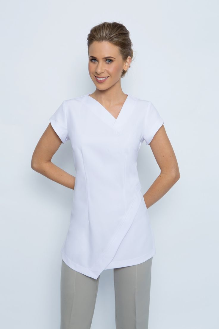 SPA14 tunic - White. Abstract hem line and neck line. Zips at rear with cap sleeves. Very cool and comfortable to wear. Easy wash and wear corporate grade fabric with stretch. This tunic is long enough to cover your back side. Sizes available; 4-26 this tunic is true to size. View our sizing chart to determine your size. Colours available; black, white, electric blue, hot pink, charcoal grey.