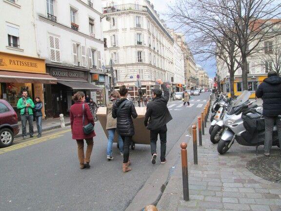 people walking a package along the street, probably flat screen tv, oberkampf, paris, jan14