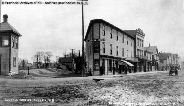 Main Street and Maple Ave. Where McAfee's drug store was in the 60's. these old black and whites came from the NB provincial archives.