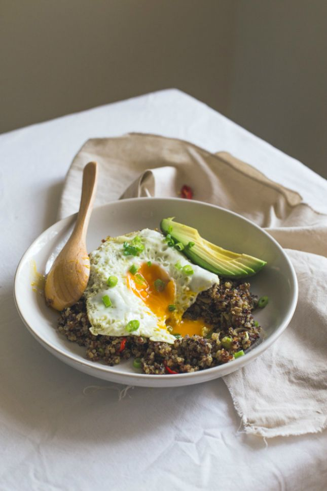 Use quinoa, sliced avocado and a fried eggs to make this breakfast bowl.