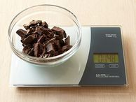 Touchless kitchen scale weighs in with a wave The Salter for Williams-Sonoma Touchless Tare Glass Scale allows for hands-free operation. The scale can also measure liquid ingredients.