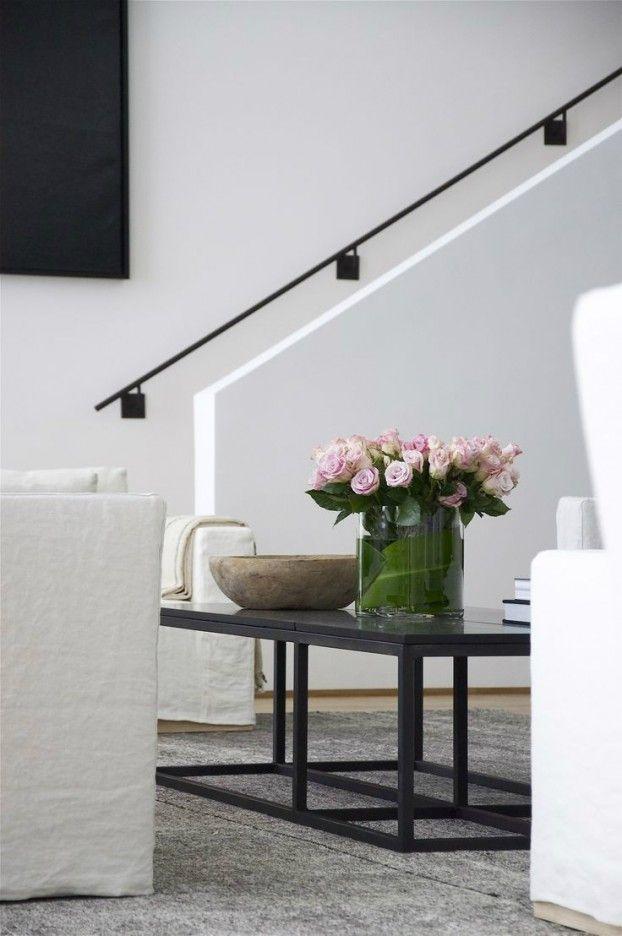 simple stair railing detail, black metal against white wall
