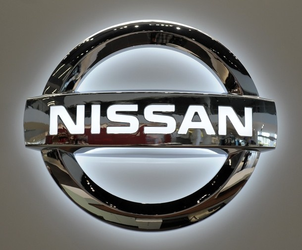 A Nissan logo is displayed on the wall of the showroom at its headquarters in Yokohama
