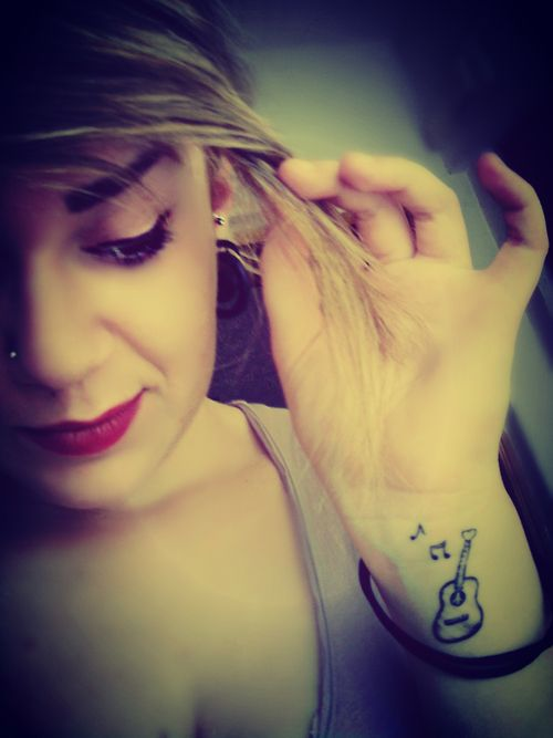 music tattoo. Love this but would rather have a flying V