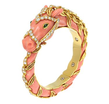 A Carved Coral, Coral and Emerald Horse Bangle Bracelet, by Van Cleef & Arpels circa 1975