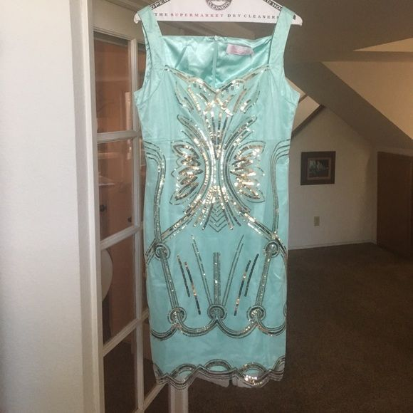 Mint colored dress with gold sequins! A semi-formal dress in a mint color with a beautiful pattern of gold sequins! Size says XL but fits a Small..NWT has a beautiful lining.. Dresses