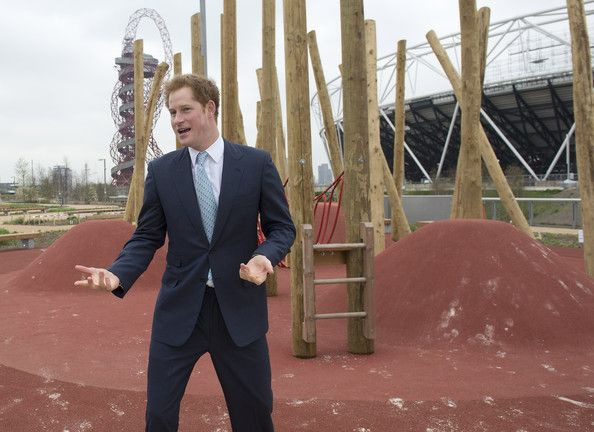 HRH Prince Harry explores a new playground with a group of children from Gainsborough Primary school in Newham during an official visit to Queen Elizabeth Olympic Park with the Mayor of London, Boris Johnson on April 4, 2014