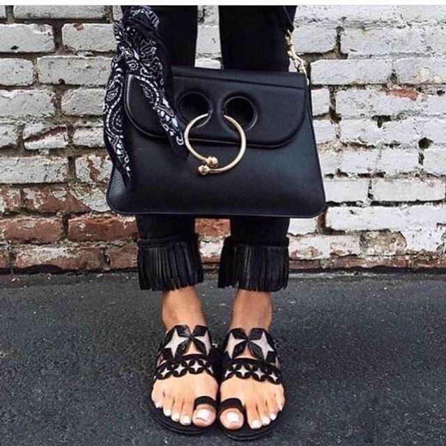 It's all in the details: a classic black bag with a statement sandal…