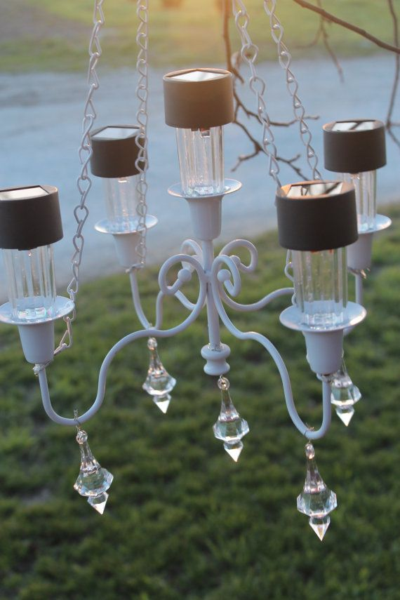 Ok so listen...this is gorge and no power required- solar bulbs in an old chandelier- thrift that shit! And like buy cheap solar stuff, and then hang it. BINGO BANGO AWESOME-O.  Outdoor Solar Chandelier by WhiteBarnCreations on Etsy, $52.00