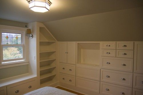 The lower ceiling, canted walls and opportunity for built-ins makes the upstairs (attic) rooms