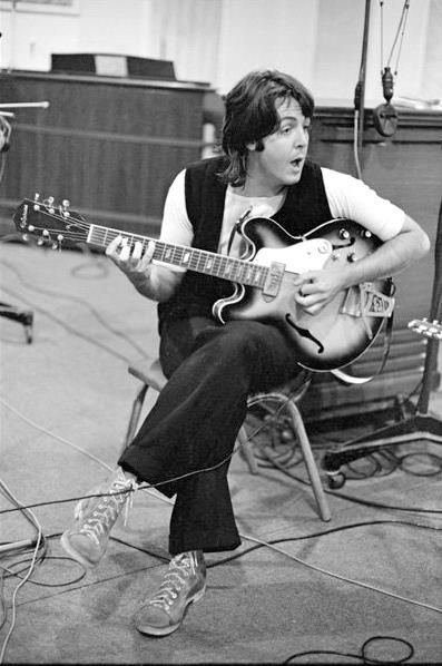 The Beatles' Abbey Road recording session, 1969: Paul McCartney with his favorite Epiphone Casino electric guitar.