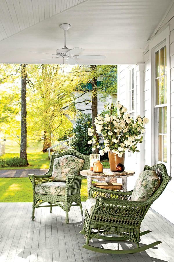 Green wicker on the porch.