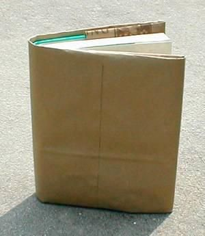 Who remembers covering their school books with a brown paper bag? We drew our own designs on them.